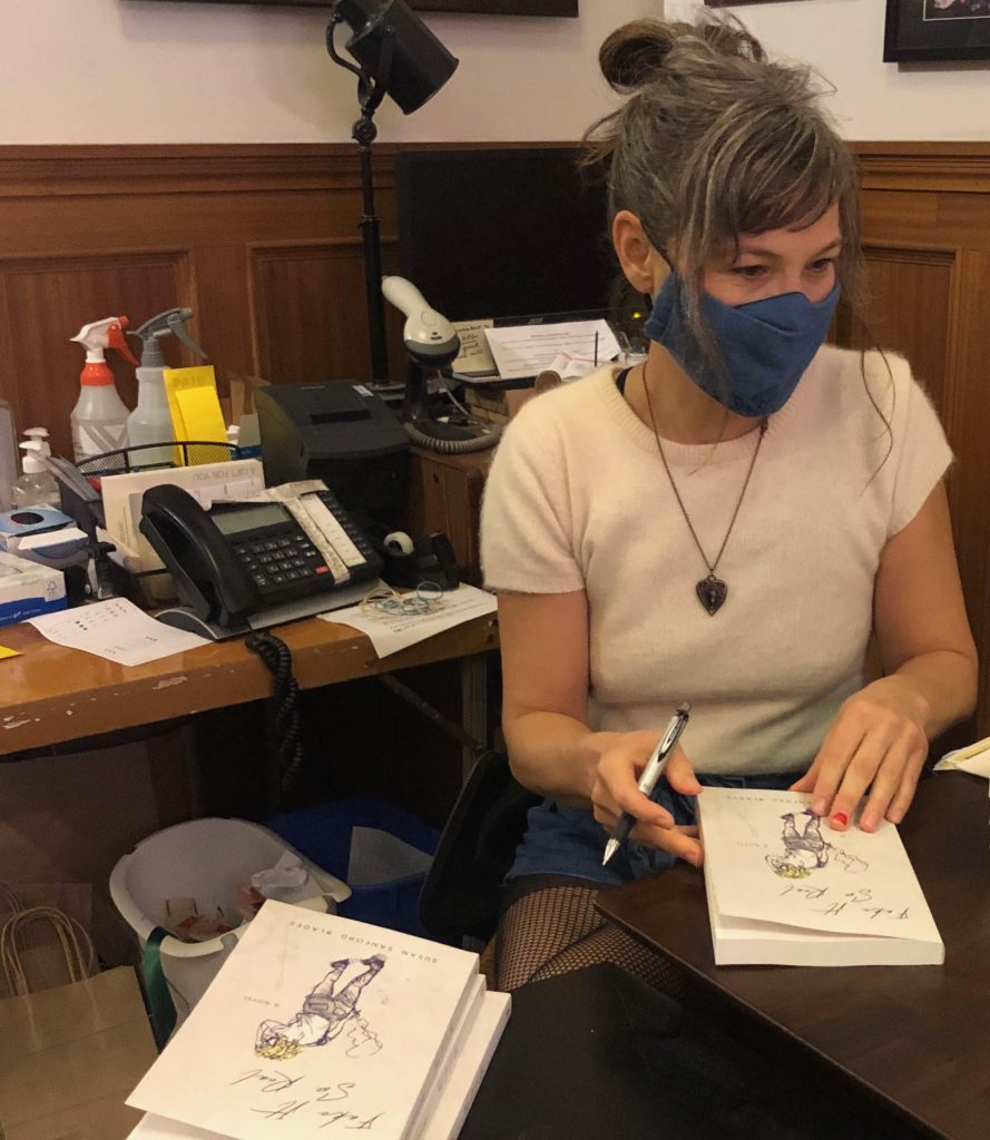 susan sandford blades signs books wearing a mask